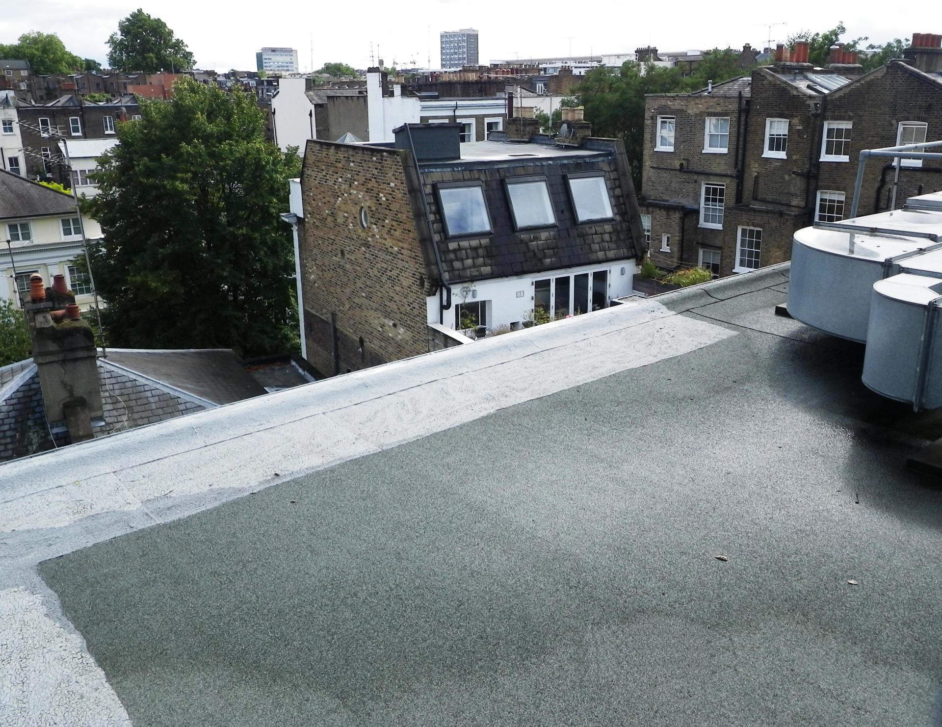 Aerial roof survey of West London property using a camera mounted on a telescopic pole